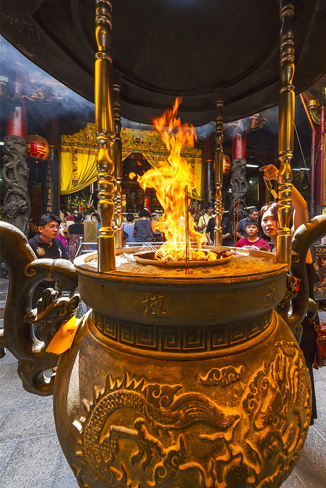 Incense and paper offerings burning in an incense burner at the Altar of Heaven (Tiantan), Tainan, Taiwan