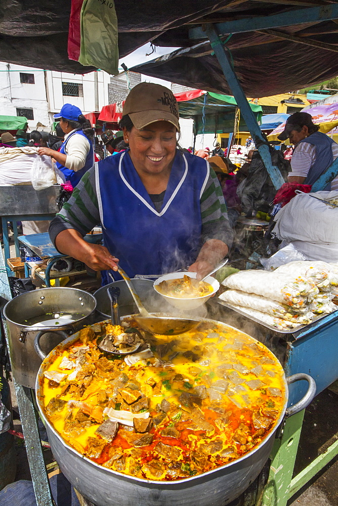 Woman serving food at an eatery at the Thursday market, Guamote, Chimborazo, Ecuador