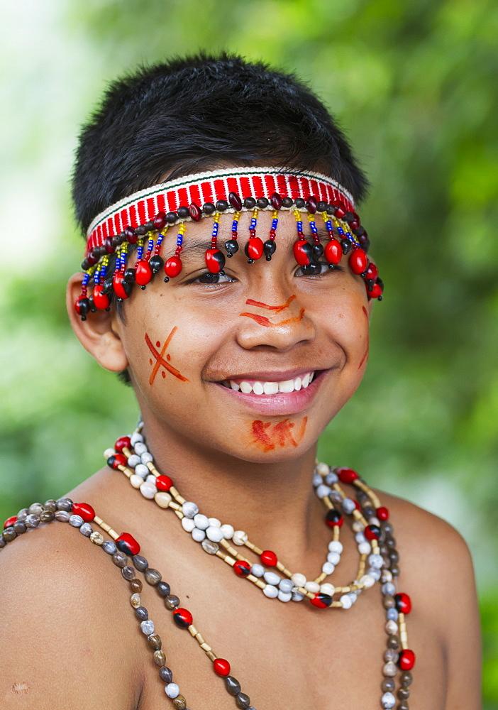 Shuar boy wearing traditional dress, Limon, Guayas, Ecuador