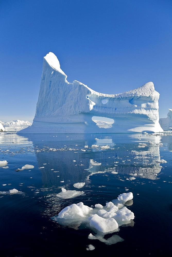 Gigantic Iceberg And Its Reflection In Wilhelmina Bay Off Enterprise Island In The Antarctic Peninsula