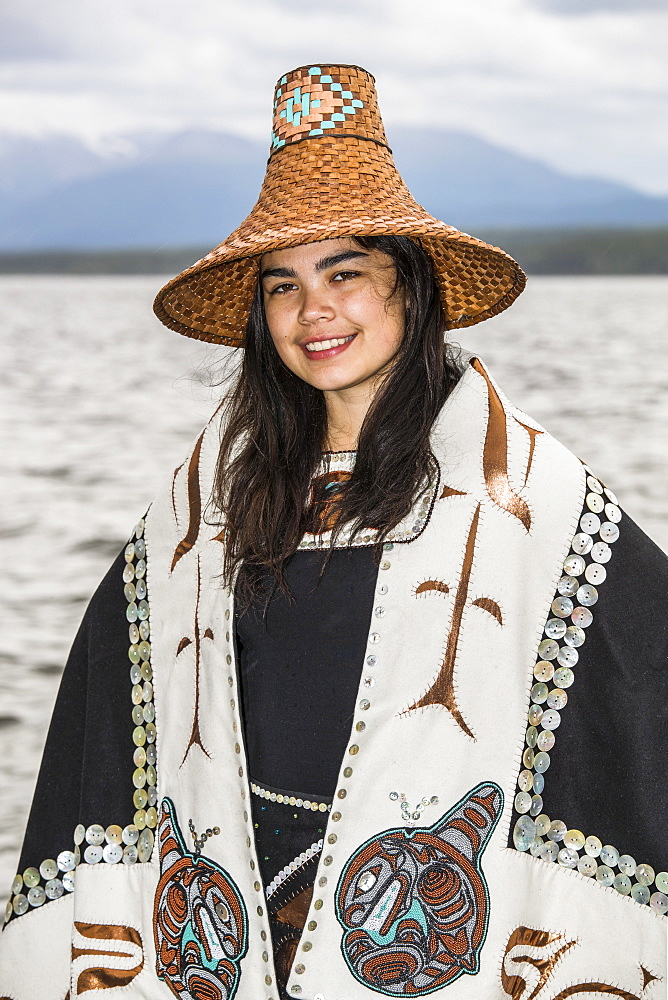 Tlingit first nation woman in traditional wardrobe on the shores of Teslin Lake, Teslin, Yukon, Canada