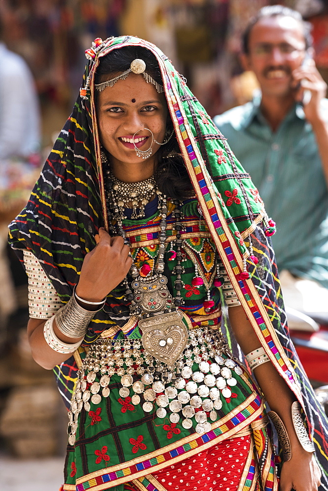 Portrait of a Hindu Indian woman in colourful traditional clothing and accessories, Jaisalmer Fort, Jaisalmer, Rajasthan, India