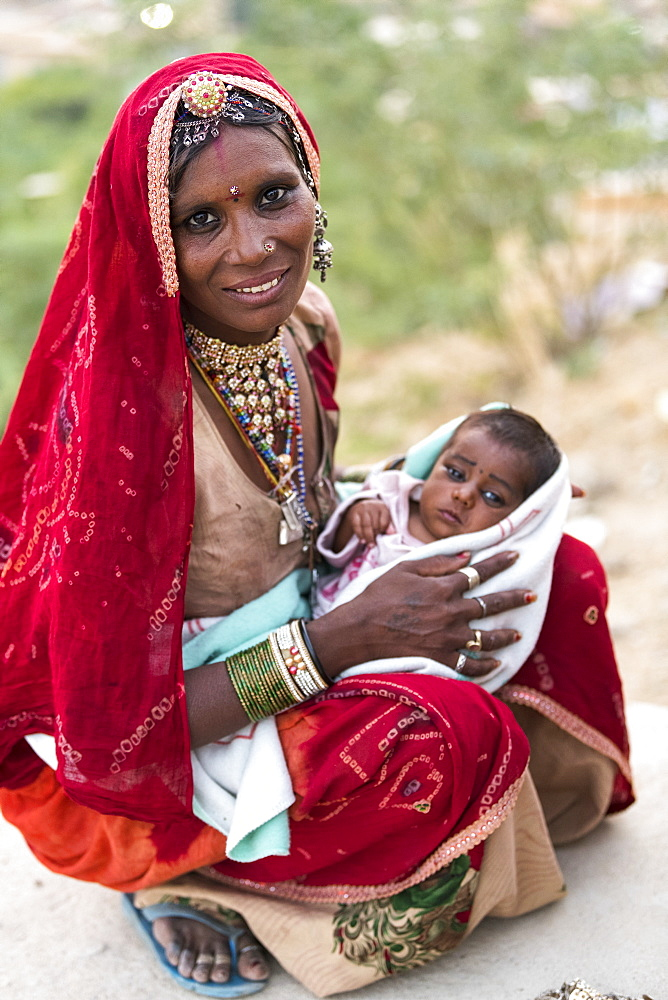 A mother holding her baby girl, Jaisalmer, Rajasthan, India - 1116-39914