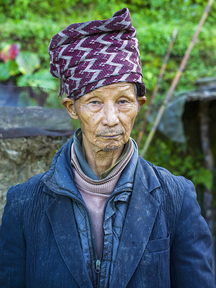 Portrait of a senior Indian man with a hat, Sikkim, India