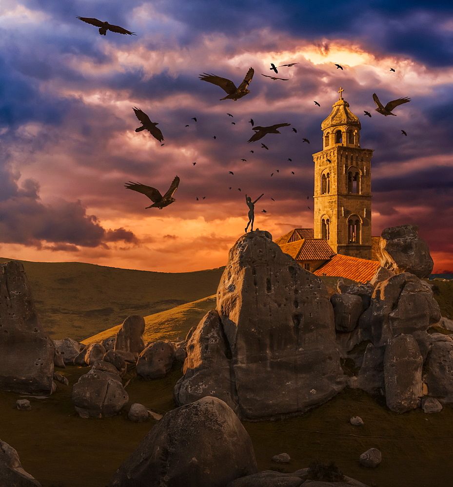 Crows flying towards a church tower with a wooden human mannequin laying on the ground in the foreground - 1116-43318