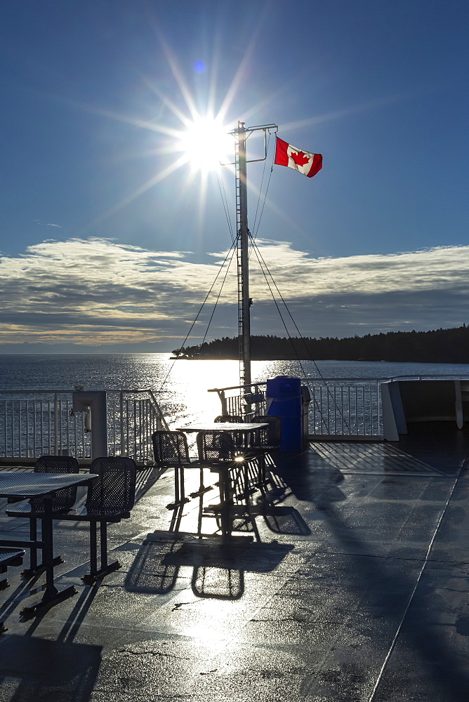 Deck of the new BC Ferry with a Canadian Flag, going to Mayne Island, British Columbia, Canada