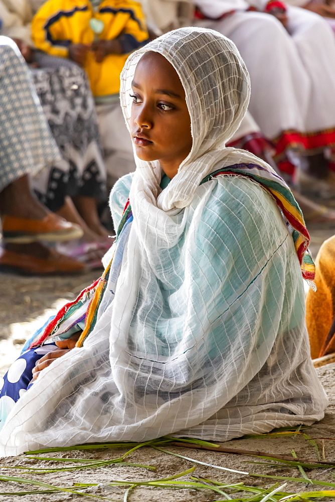 A young Ethiopian girl at the Church of Saint George during Timkat, the Orthodox Tewahedo celebration of Epiphany, celebrated on January 19th, Ziway, Oromia Region, Ethiopia