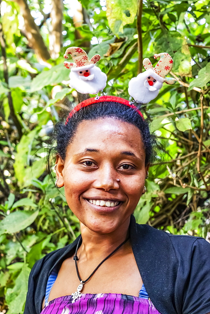 Ethiopian woman wearing a Christmas headband, Lake Tana, Amhara Region, Ethiopia