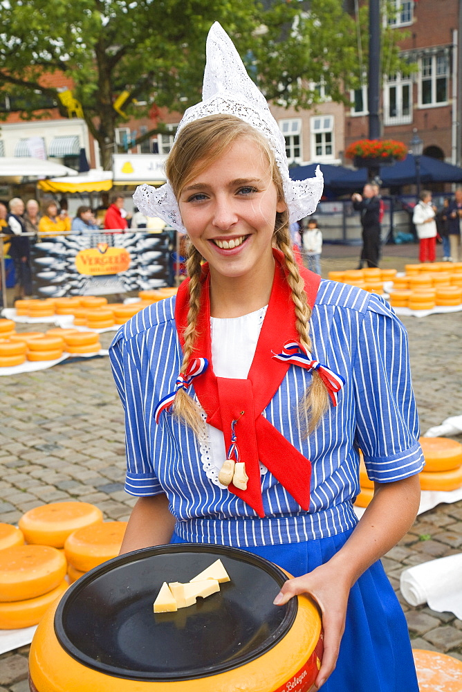 Pretty young woman in Dutch national costume at Gouda cheese market, Netherlands, Europe - 1121-1
