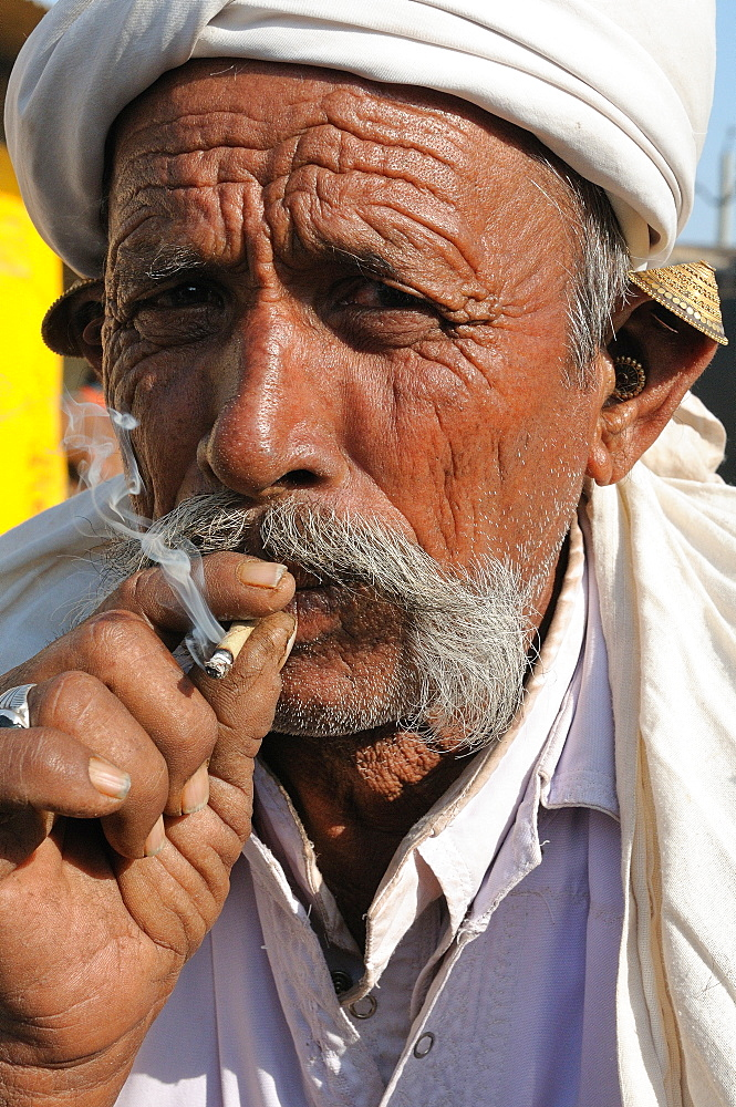 Smoking beedies by men in rural India, Gujarat, India, Asia