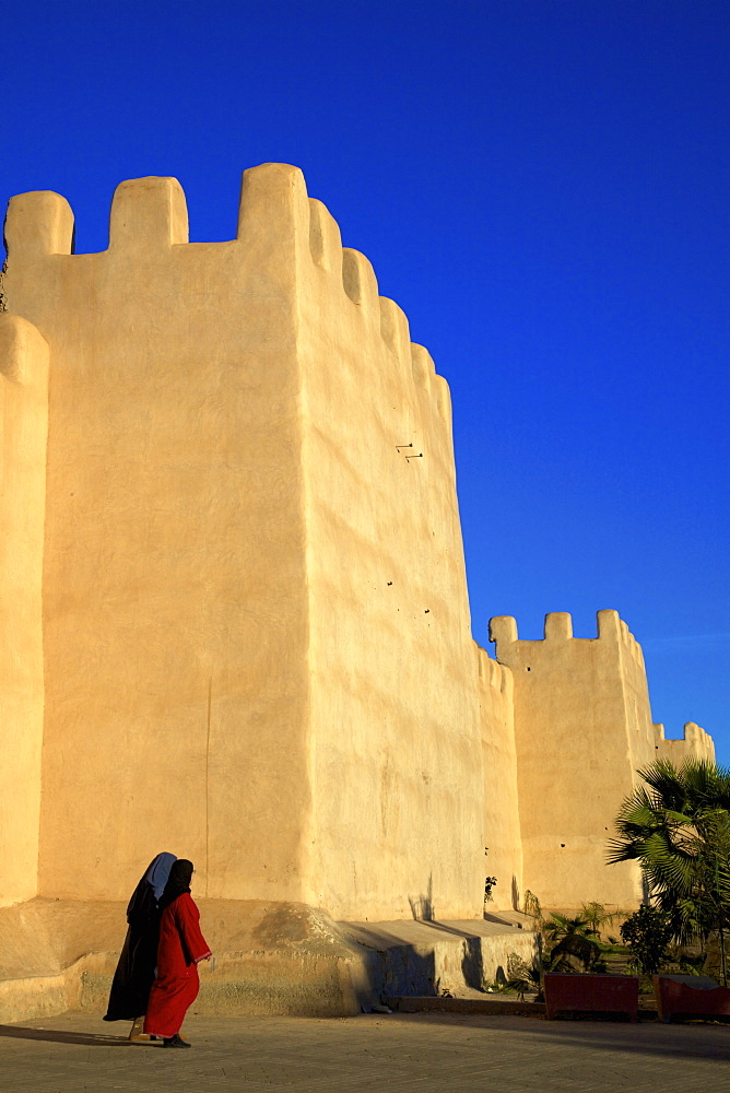 Women in traditional dress with Old City wall, Taroudant, Morocco, North Africa, Africa