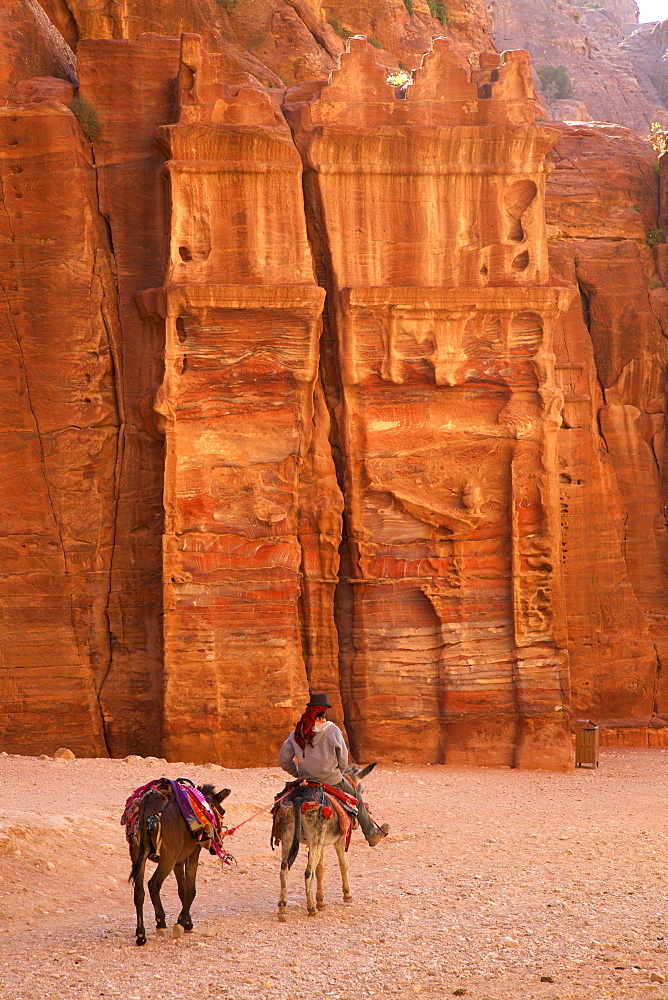 Bedouin riding donkey in the Siq, Petra, UNESCO World Heritage Site, Jordan, Middle East