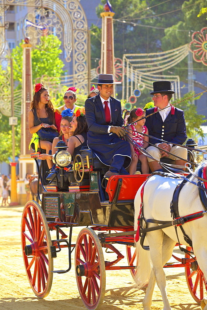 People on horse-drawn carriage, Annual Horse Fair, Jerez de la Frontera, Cadiz Province, Andalusia, Spain, Europe