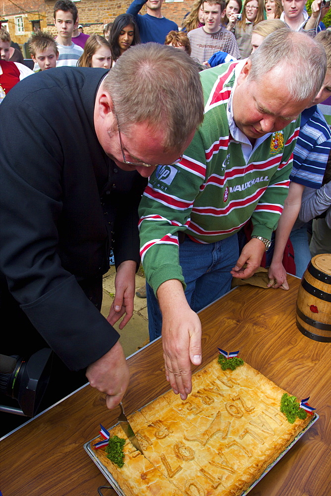 Cutting of the Hare Pie for the Old Annual Custom of Bottle-kicking, Hallaton, Leicestershire, England, United Kingdom, Europe