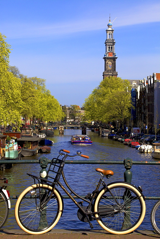 Westerkerk Tower and Prinsengracht Canal with bicycle, Amsterdam, Netherlands, Europe