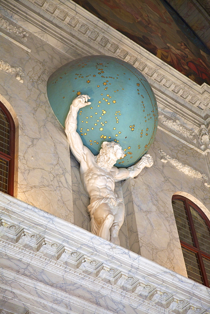 Statue of Atlas holding the Universe on his shoulders in the Royal Palace, Amsterdam, Netherlands, Europe