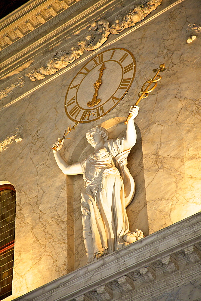 Clock and statue in Royal Palace, Amsterdam, Netherlands, Europe