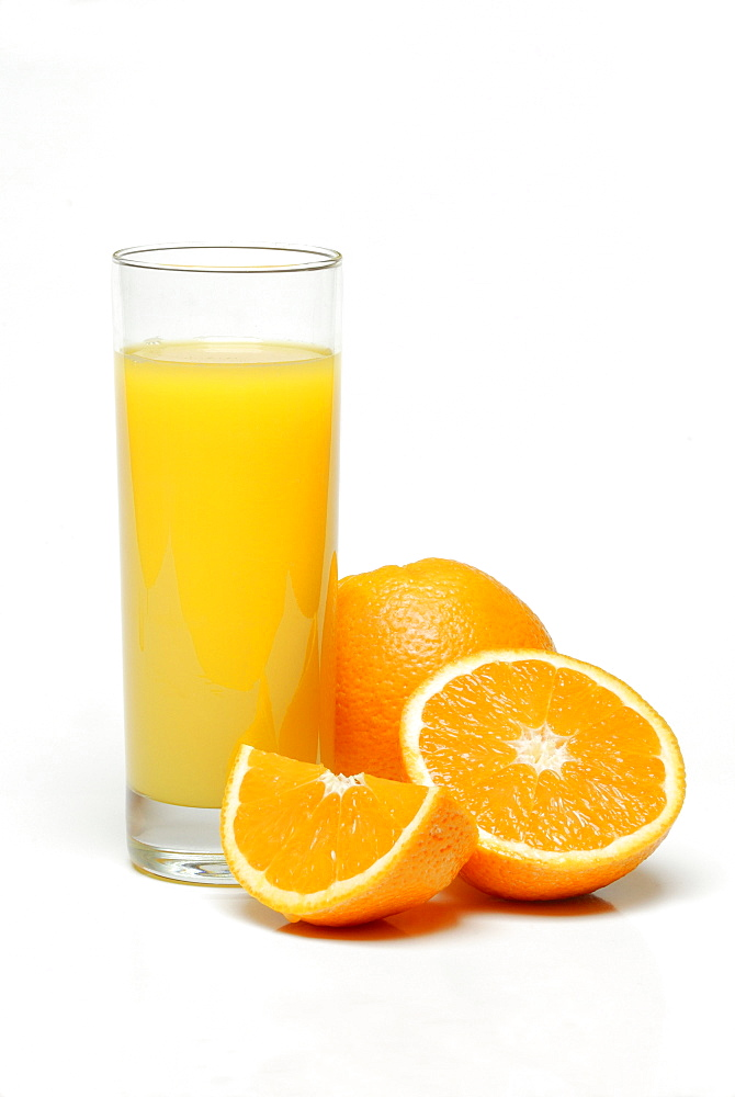 Glass of orange juice, oranges