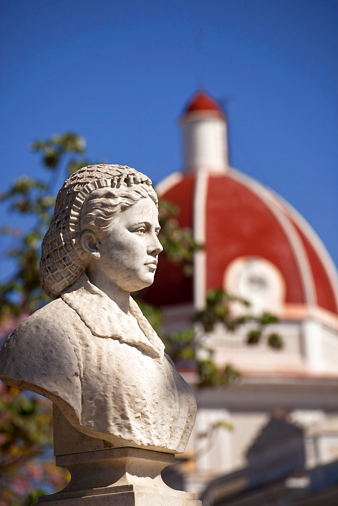 bust at Parque Jose Marti and the colourful dome of the Ayuntamiento City Hall in Cienfuegos, Cuba, Caribbean