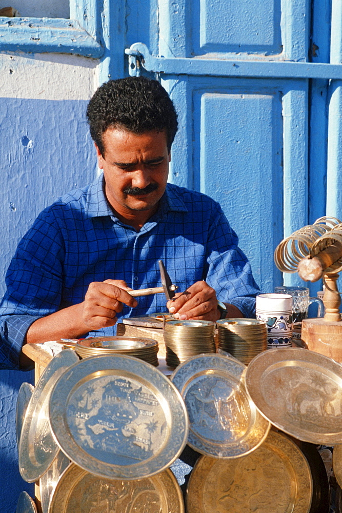 Man decorating plates, Sidi Bou Said, Tunisia