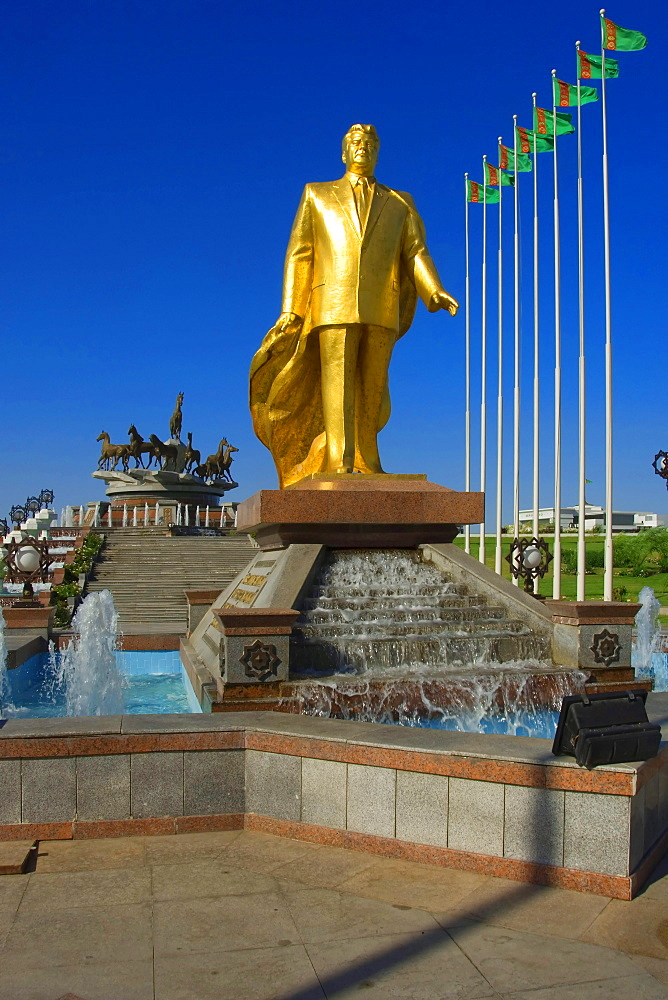Gold covered statue, President Turkmenbasy, in front of monument of the 10th anniversary of Independence, Ashgabat, Turkmenistan / Asgabat