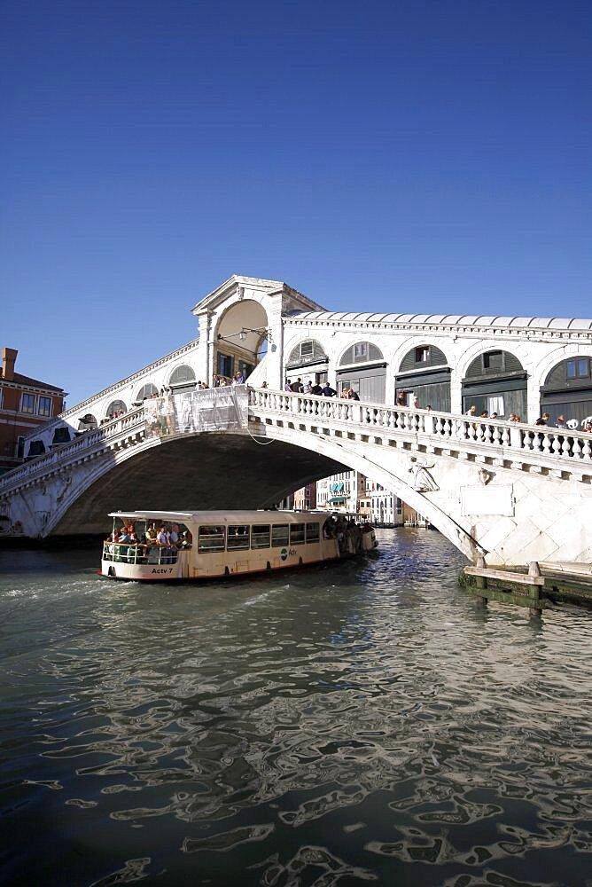 Public ferry and the Rialto Bridge over the Grand Canal, Venice, UNESCO World Heritage Site, Veneto, Italy, Europe