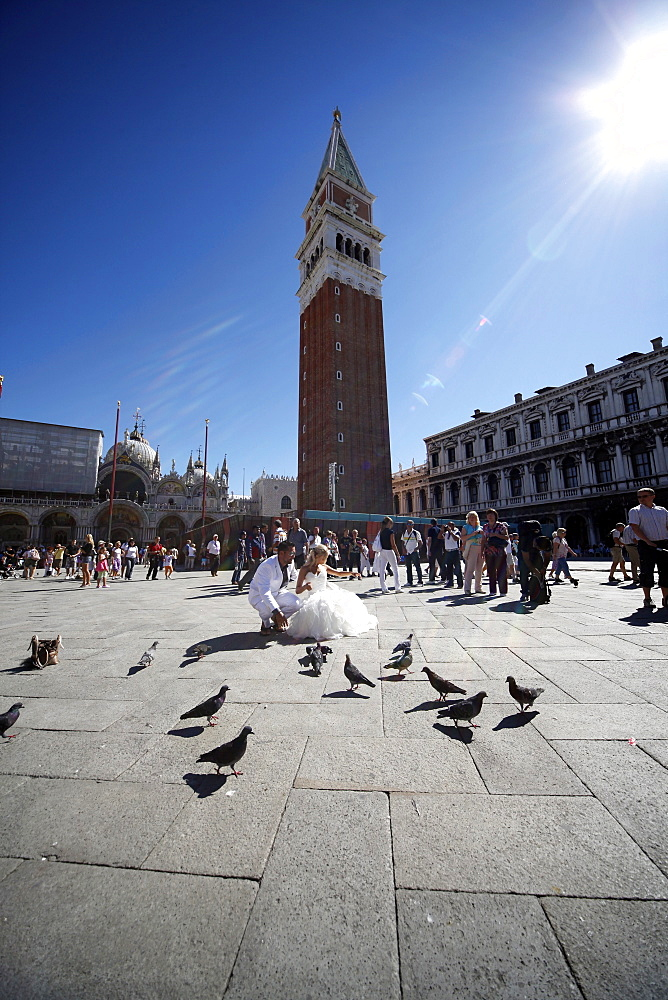 Wedding bride and groom with Campanile behind in Piazza San Marco, Venice, UNESCO World Heritage Site, Veneto, Italy, Europe