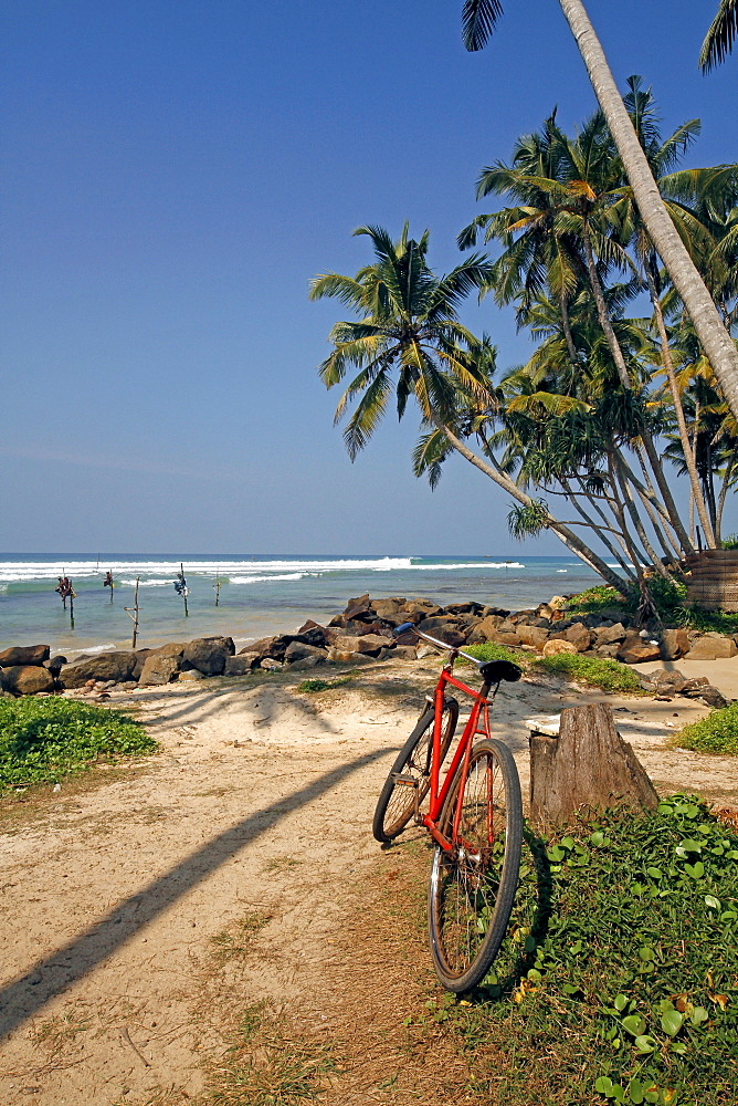 Red bicycle and Indian Ocean, Weligama, Sri Lanka, Asia