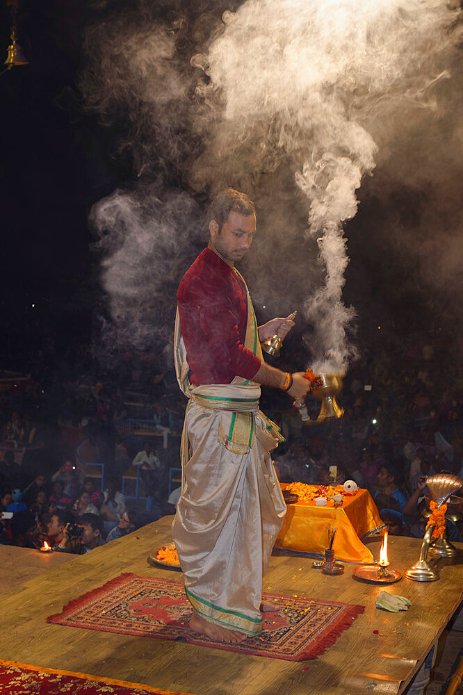 Priest celebrating the river Ganges Aarti by offering incense, Dashashwamedh Ghat, Varanasi, Uttar Pradesh, India - 1131-1313