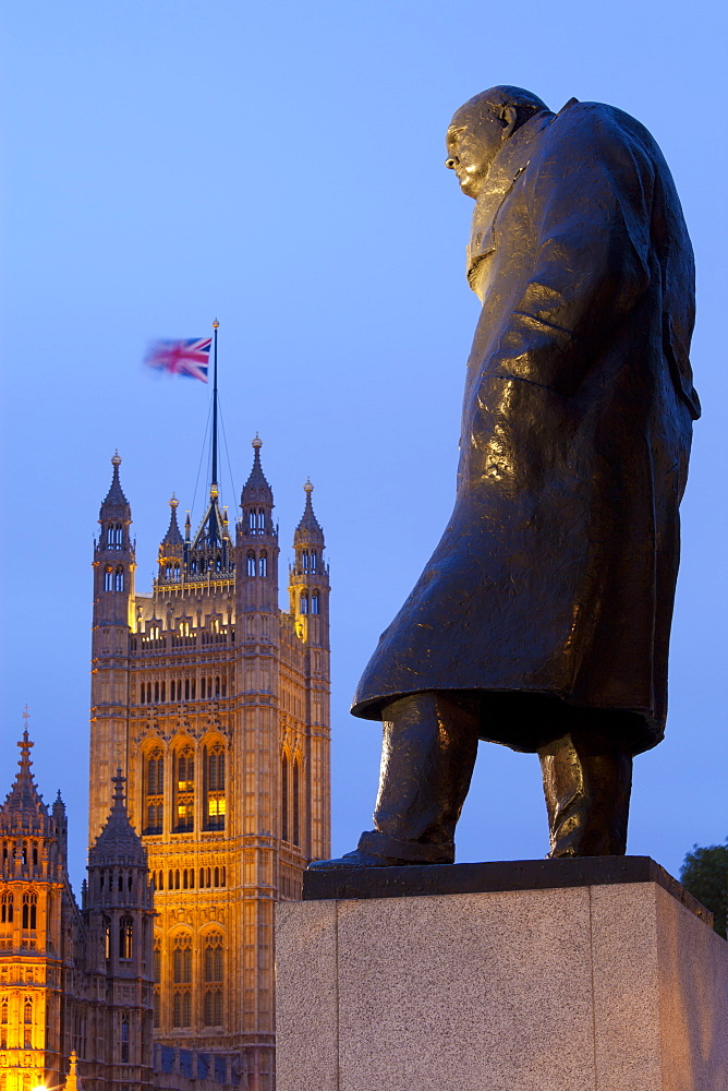 Winston Churchill statue and the Houses of Parliament at night, London, England, United Kingdom, Europe