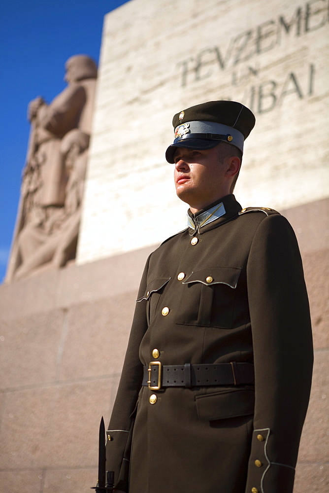 Soldier in front of the Latvian Freedom Monument, Riga, Latvia, Europe