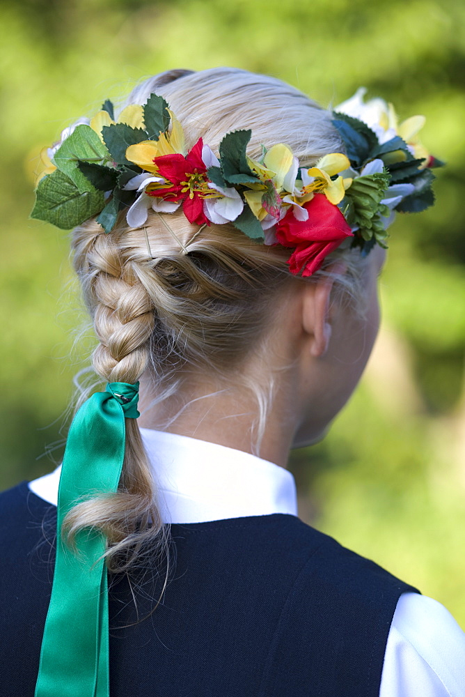 Head dress detail of young woman in Folk Costume, Riga, Latvia, Europe