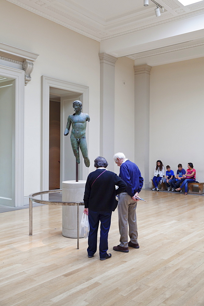 Visitors looking at a sculpture, British Museum, Bloomsbury, London, England, United Kingdom, Europe