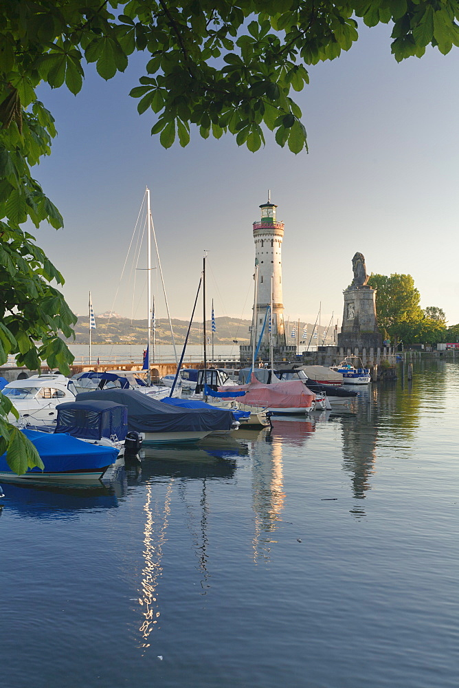 Lighthouse and Bavarian Lion at the port at sunset, Lindau, Lake Constance, Bavaria, Germany, Europe