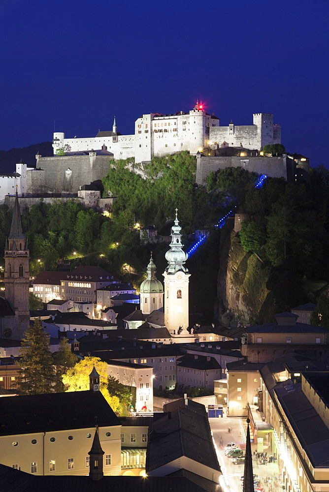 High angle view of the Old Town, UNESCO World Heritage Site, with Hohensalzburg Fortress and Dom Cathedral at dusk, Salzburg, Salzburger Land, Austria, Europe