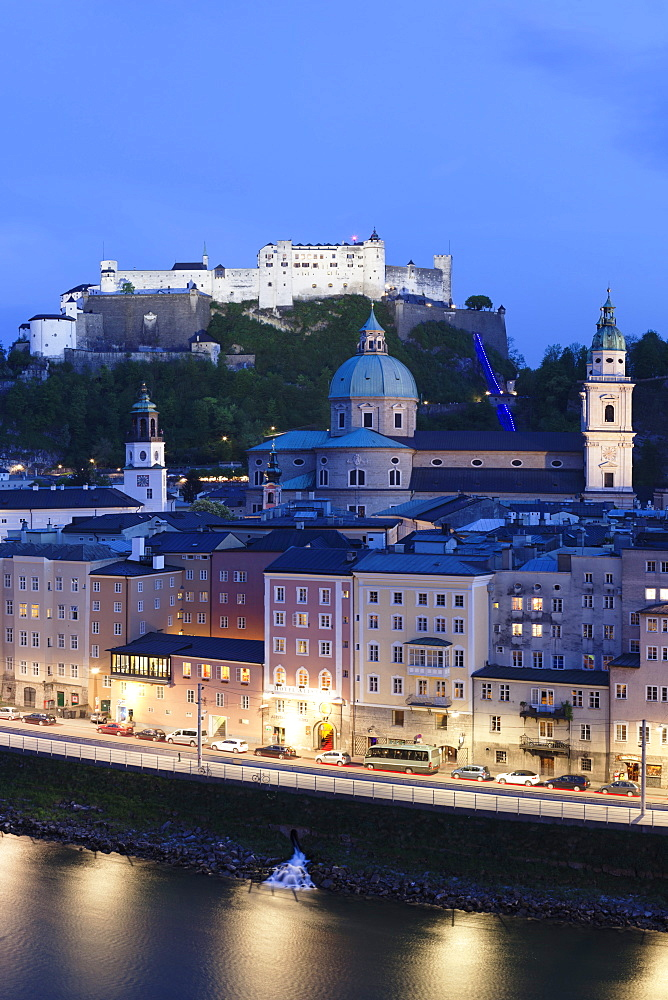 High angle view of the old town, UNESCO World Heritage Site, with Hohensalzburg Fortress, Dom Cathedral and Kappuzinerkirche Church at dusk, Salzburg, Salzburger Land, Austria, Europe