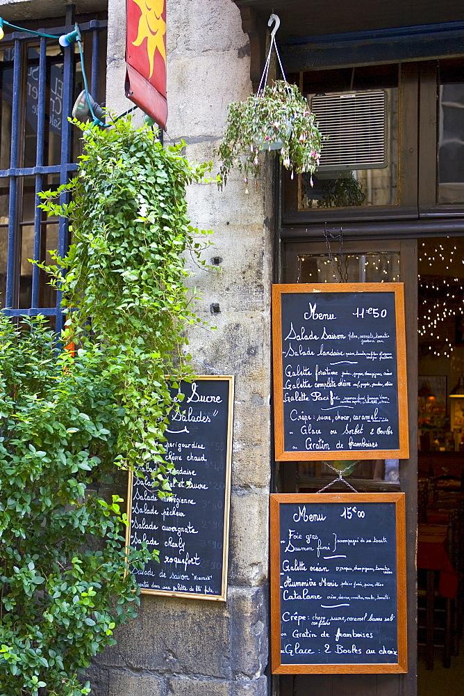 French menus outside cafe restaurant in Bordeaux, France.