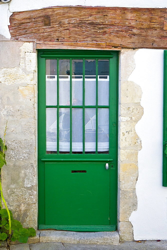 Door with net panel, Ile De Re, France.