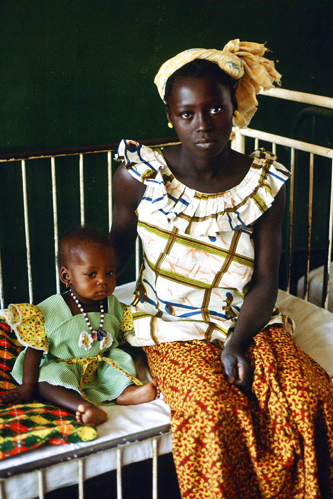 Young mother  with her child in hospital, Gambia