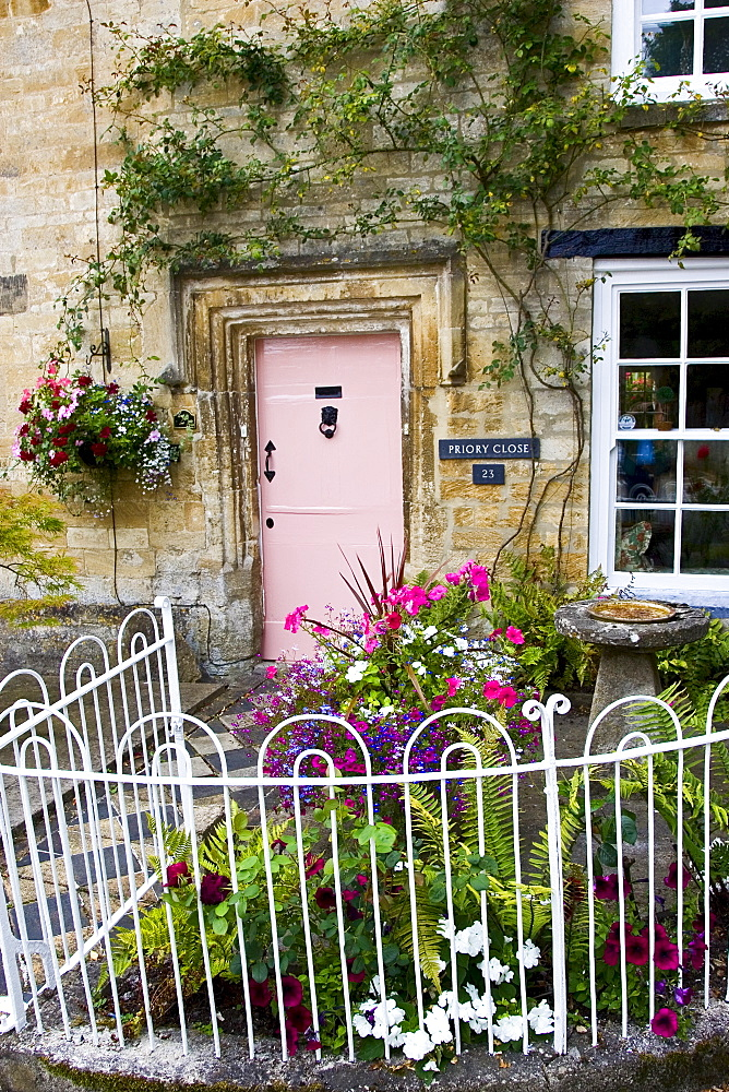 Cotswolds cottage and fenced front garden, Burford, Oxfordshire, UK