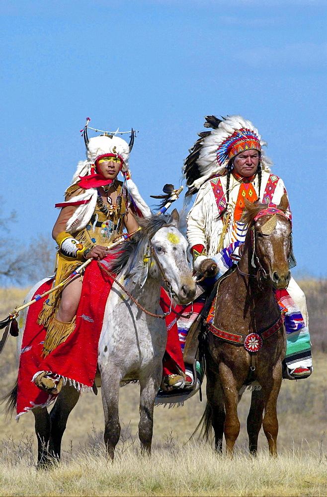 Canadian Plains Indians chiefs on horseback at cultural display at Wanuskewin Heritage Park in Saskatoon, Canada
