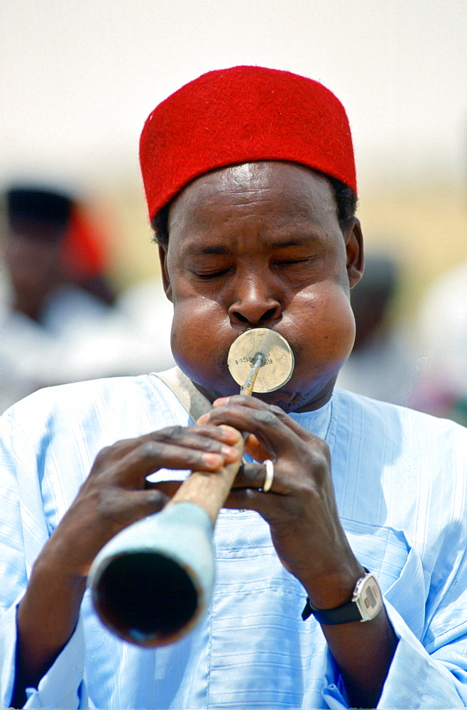 Musician playinga  traditional wind instrument, Nigeria