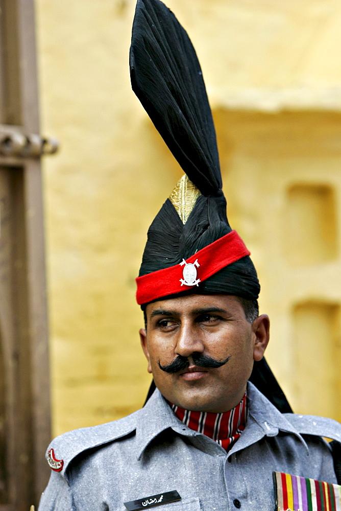 Pakistani ceremonial guard outside Sikh Temple Gurdwara of Arjan Dev, Lahore, Pakistan