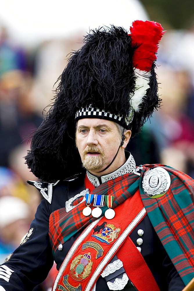 Drum Major of massed band of Scottish pipers at Braemar Games Highland Gathering, Scotland