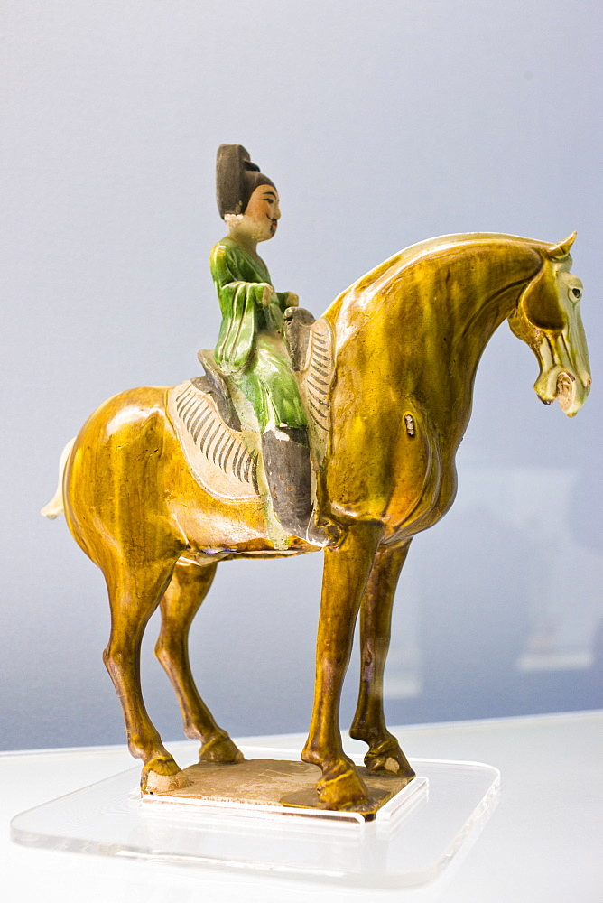 Sancai pottery figure on horseback on display in the Shanghai Museum, China