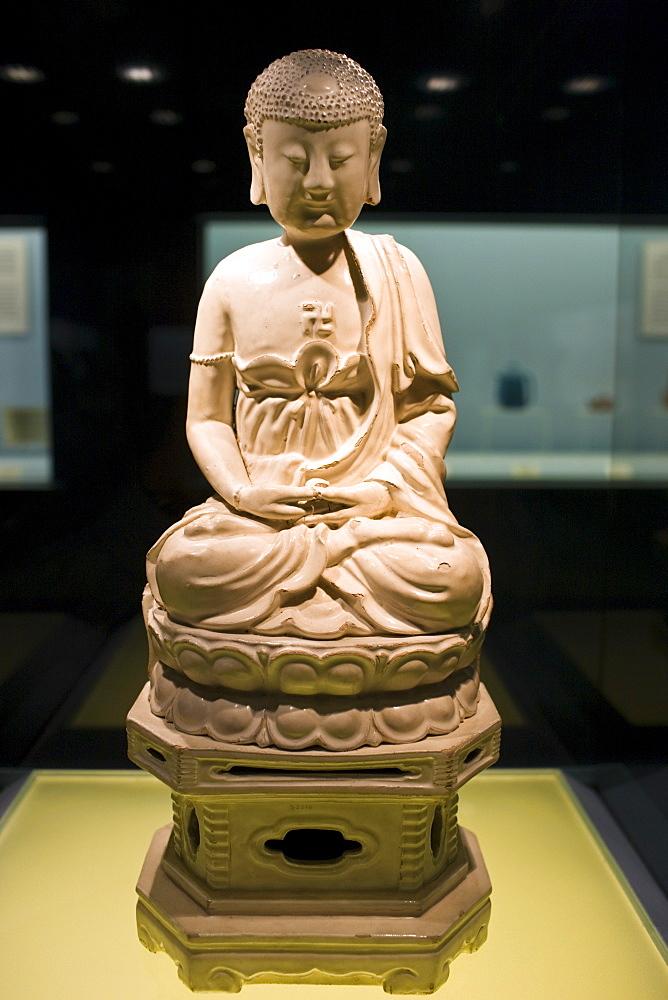 Ceramic Buddha figure on display in the Shanghai Museum, China