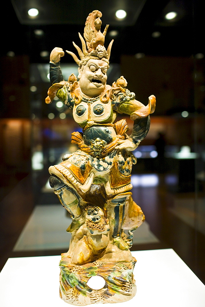 Figurine on display in glass case in the Shaanxi History Museum, Xian, China