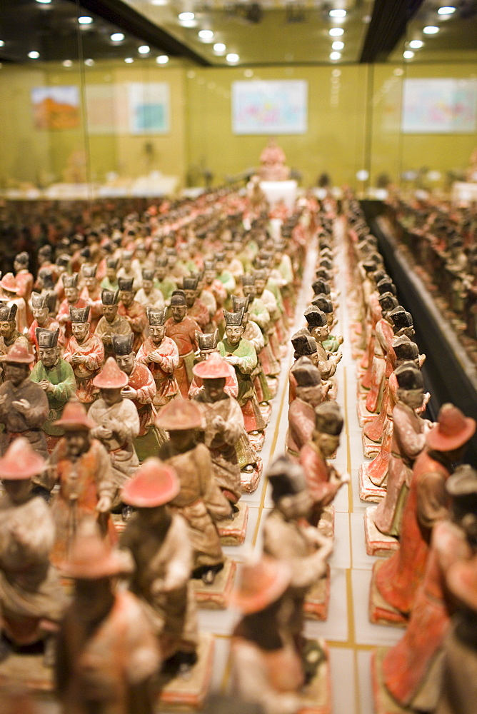 Figurines on display in glass case in the Shaanxi History Museum, Xian, China