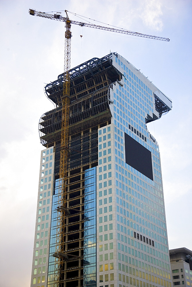 Modern glass skyscraper being built at Olympic site in Beijing, China