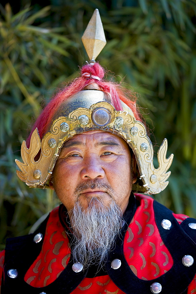 Man dressed in Mongolian Warrior costume at The Great Wall of China, Mutianyu, north of Beijing - 1161-3562